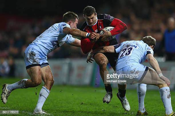 Jonny May of Gloucester is held up by Alex Grove and Max Stelling of Worcester during the European Rugby Challenge Cup Round Four match between...