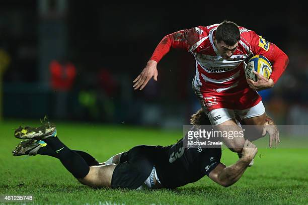 Jonny May of Gloucester is tackled by Marcelo Bosch of Saracens during the Aviva Premiership match between Gloucester Rugby and Saracens at Kingsholm...