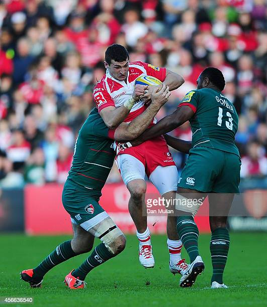 Jonny May of Gloucester is tackled by Matt Smith and Vereniki Goneva of Leicester Tigers during the Aviva Premiership match between Gloucester and...
