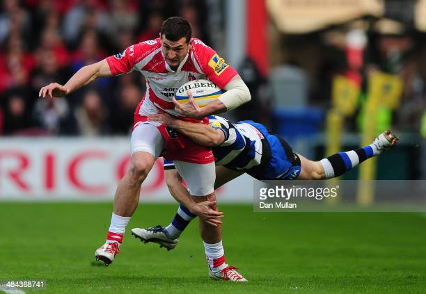 Jonny May of Gloucester is tackled by Nick Adendanon of Bath during the Aviva Premiership match between Gloucester and Bath at Kingsholm Stadium on...