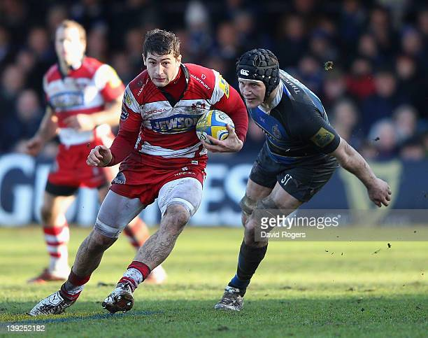 Jonny May of Gloucester moves away from Simon Taylor during the Aviva Premiership match between Bath and Gloucester at the Recreation Ground on...