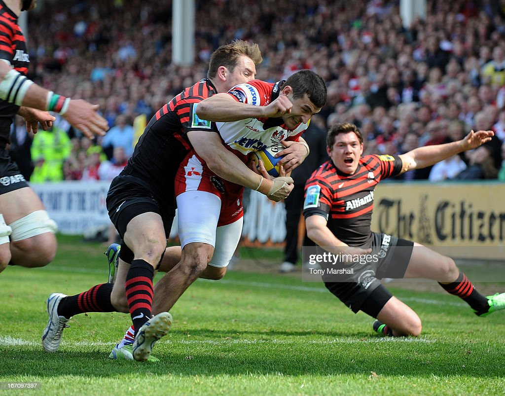 Jonny May of Gloucester on his way to scoring their first try as he is tackled by<a gi-track='captionPersonalityLinkClicked' href=/galleries/search?phrase=Chris+Wyles&family=editorial&specificpeople=764213 ng-click='$event.stopPropagation()'>Chris Wyles</a> of Saracens during the Aviva Premiership match between Gloucester and Saracens at Kingsholm Stadium on April 20, 2013 in Gloucester, England.