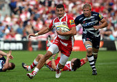Jonny May of Gloucester Rugby attacks the Sale Sharks defence during the Aviva Premiership match between Gloucester Rugby and Sales Sharks at...