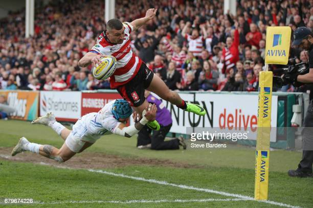 Jonny May of Gloucester Rugby is tackled into touch by Jack Nowell of Exeter Chiefs during the Aviva Premiership match between Gloucester Rugby and...