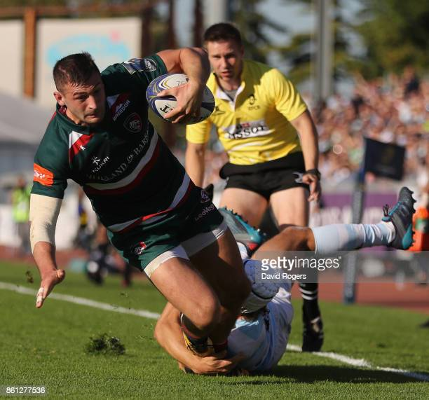Jonny May of Leicester dives over to score their second try during the European Rugby Champions Cup match between Racing 92 and Leicester Tigers at...