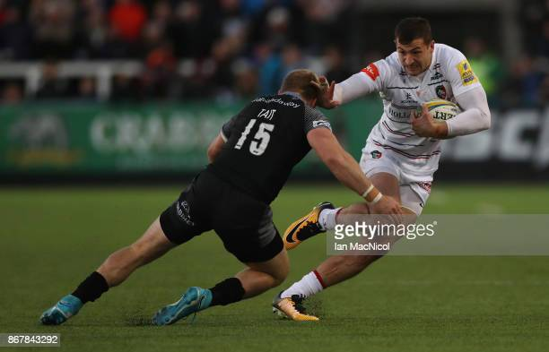 Jonny May of Leicester Tigers evades Alex Tait of Newcastle Falcons and runs through to score his teams third try during the Aviva Premiership match...