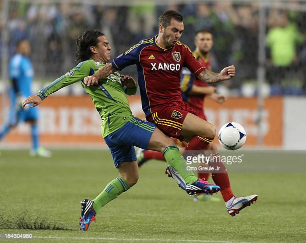 Jonny Steele of Real Salt Lake battles Mauro Rosales of the Seattle Sounders FC at CenturyLink Field on October 17 2012 in Seattle Washington