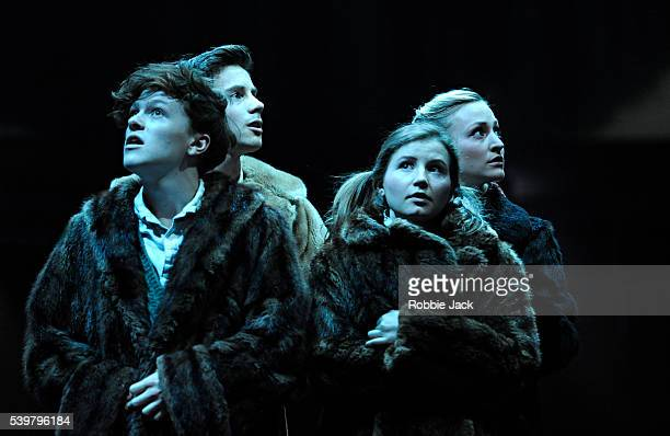 Jonny Weldon as Edmund Philip Labey as Peter Rebecca Benson as Lucy and Carly Bawden as Susan in Rupert Goold's stage adaptation of CS Lewis's The...