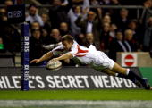 Jonny Wilkinson of England dives over in the corner to score his team's third try during the RBS Six Nations championship match between England and...