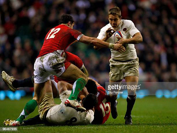 Jonny Wilkinson of England holds off Jamie Roberts of Wales during the RBS 6 Nations Championship match between England and Wales at Twickenham...