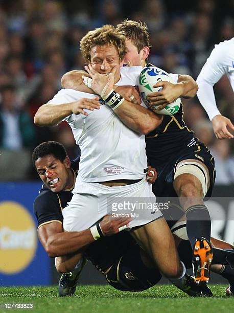 Jonny Wilkinson of England is tackled by Joe Ansbro and John Barclay of Scotland during the IRB 2011 Rugby World Cup Pool B match between England and...