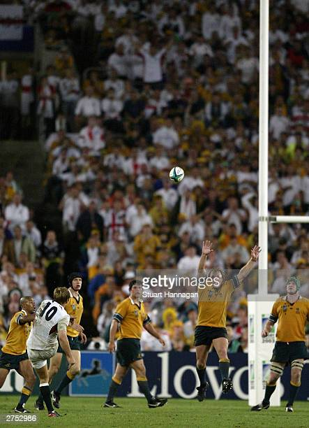 Jonny Wilkinson of England kicks the winning drop goal during extra time in the Rugby World Cup Final match between Australia and England at Telstra...