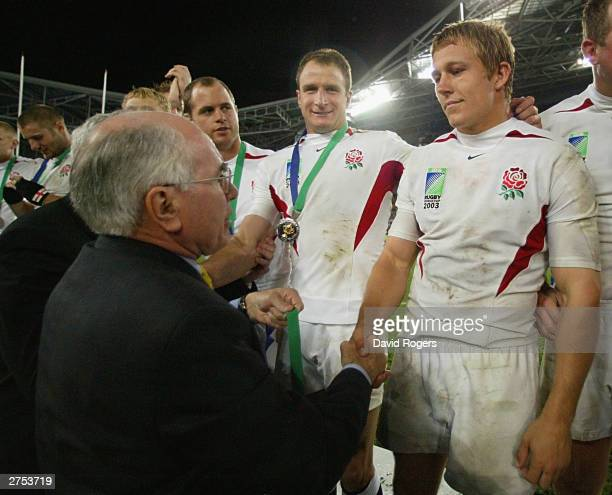 Jonny Wilkinson of England recieves his winner's medal from Australian Prime Minister John Howard after England's victory in the Rugby World Cup...