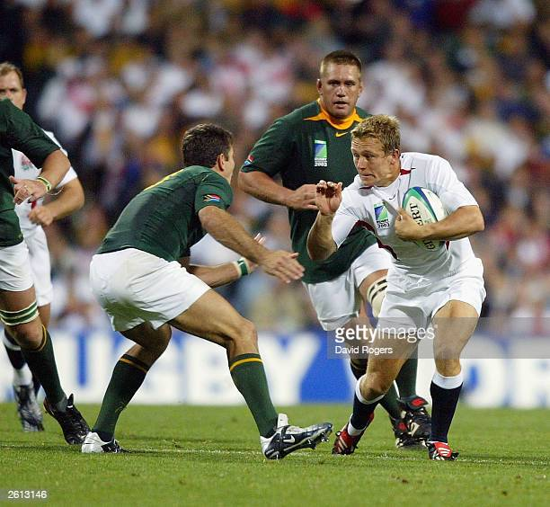 Jonny Wilkinson of England takes on Joost van der Westhuizen during the Rugby World Cup Pool C match between South Africa and England at Subiaco Oval...
