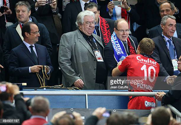 Jonny Wilkinson of RC Toulon is congratulated by Prince Albert of Monaco while French President Francois Hollande looks on after the Top 14 Final...