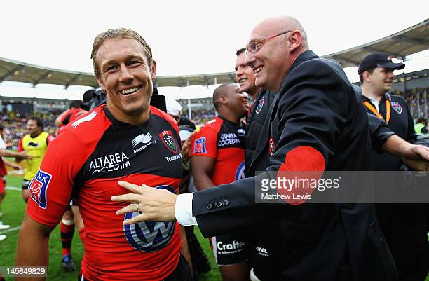Jonny Wilkinson of Toulon celebrates his teams win with Bernard Laporte Director of Rugby at Toulon during the French Top 14 Semi Final match between...