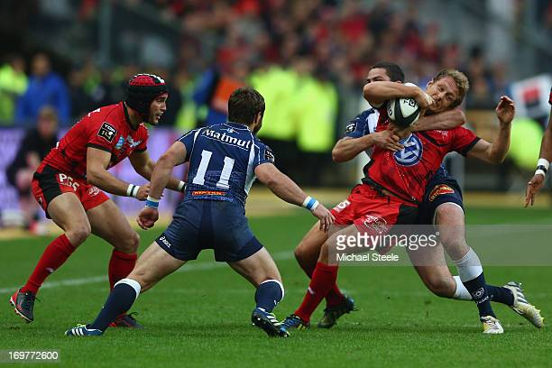 Jonny Wilkinson of Toulon feels the force from Remi Tales of Castres Olympiqueduring the Top 14 Final match between Castres Olympique and Toulon at...