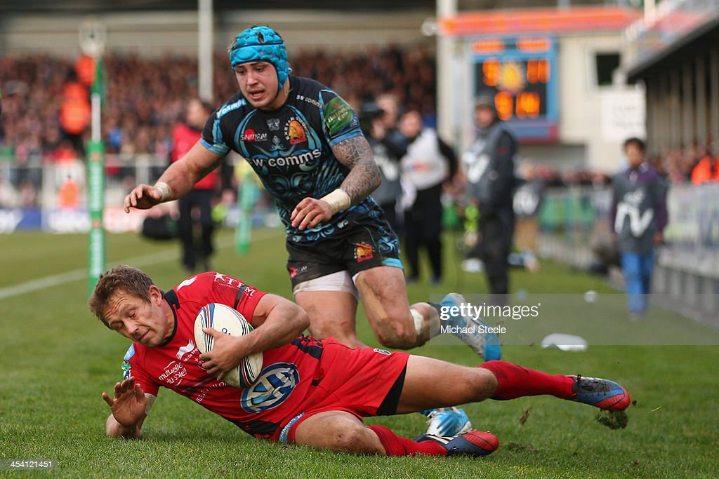 Jonny Wilkinson of Toulon is bundled into touch by Jack Nowell of Exeter Chiefs during the Heineken Cup Pool Two match between Exeter Chiefs and Toulon at Sandy Park on December 7, 2013 in Exeter, England.