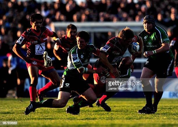 Jonny Wilkinson of Toulon is tackled by Johnny O'Conor and Ian Keatley of Connacht during the Amlin Challenge Cup SemiFinal match between Connacht...