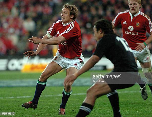 Jonny Wilkinson passes as Tana Umaga closes in during the All Blacks 4818 win over the British and Irish Lions in their second rugby test in...