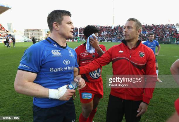 Jonny Wilkinson the Toulon captain commiserates with Brian O'Driscoll after Toulon's victory during the Heineken Cup quarter final match between...