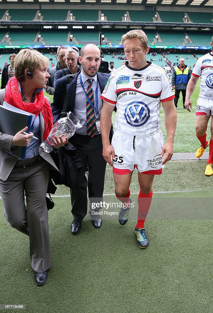 <a gi-track='captionPersonalityLinkClicked' href=/galleries/search?phrase=Jonny+Wilkinson&family=editorial&specificpeople=159417 ng-click='$event.stopPropagation()'>Jonny Wilkinson</a>, who kicked all of Toulon's match winning points is the centre of attention as he leaves the pitch after their victory during the Heineken Cup semi final match between Saracens and Toulon at Twickenham Stadium on April 28, 2013 in London, United Kingdom.