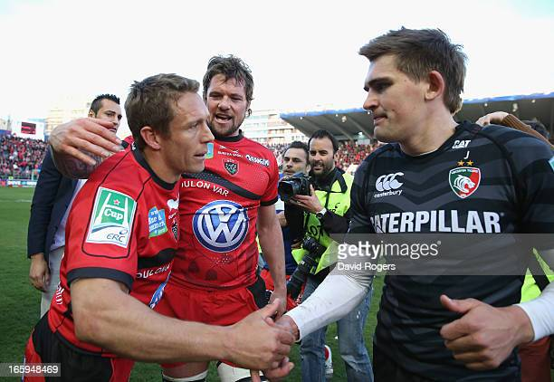 Jonny Wilkinson who kicked all of Toulon's points commiserates with his opposite number Toby Flood of Leicester after their victory after the...
