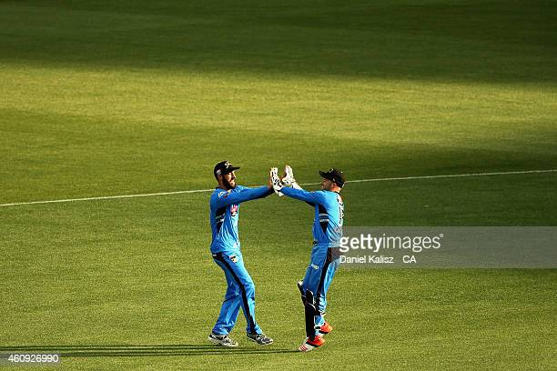 Jono Dean of the Adelaide Strikers celebrates with Tim Ludeman of the Adelaide Strikers after taking a catch during the Big Bash League match between...