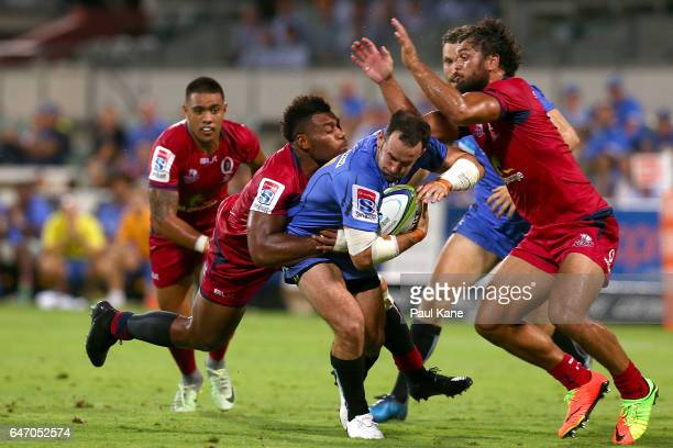 Jono Lance of the Force gets tackled by Samu Kerevi of the Reds during the round two Super Rugby match between the Western Force and the Reds at nib...