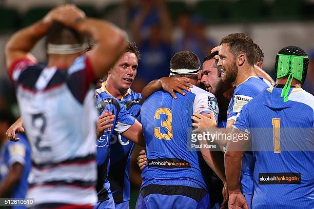 Jono Lance of the Force is congratulated by team mates after crossing for a try during the round one Super Rugby match between the Force and the...