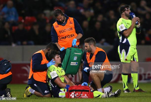 Jono Ross of Sale Sharks receives treatment after being fouled by Mike Coman of London Irish who was subsequently sent off during the Aviva...