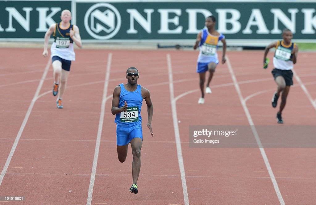 Jonothan Ntutu runs in the 200m during day 3 of The Nedbank National Championships for the Physically Disabled at LC de Villiers Stadium on March 25, 2013 in Pretoria, South Africa.