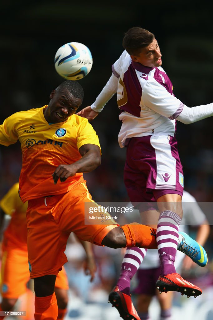 Jon-Paul Pittman (L) of Wycombe Wanderers leaps alongside <a gi-track='captionPersonalityLinkClicked' href=/galleries/search?phrase=Matthew+Lowton&family=editorial&specificpeople=8309591 ng-click='$event.stopPropagation()'>Matthew Lowton</a> (R) of Aston Villa during the Pre Season Friendly match between Wycombe Wanderers and Aston Villa at Adams Park on July 20, 2013 in High Wycombe, England.