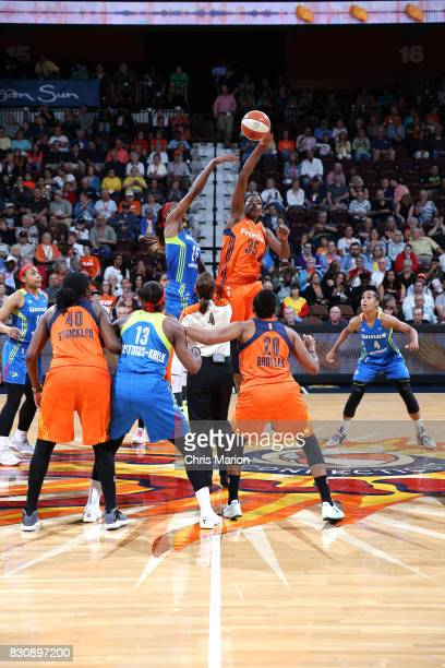 Jonquel Jones of the Connecticut Sun goes for the jump ball against Glory Johnson of the Dallas Wings on August 12 2017 at Mohegan Sun Arena in...