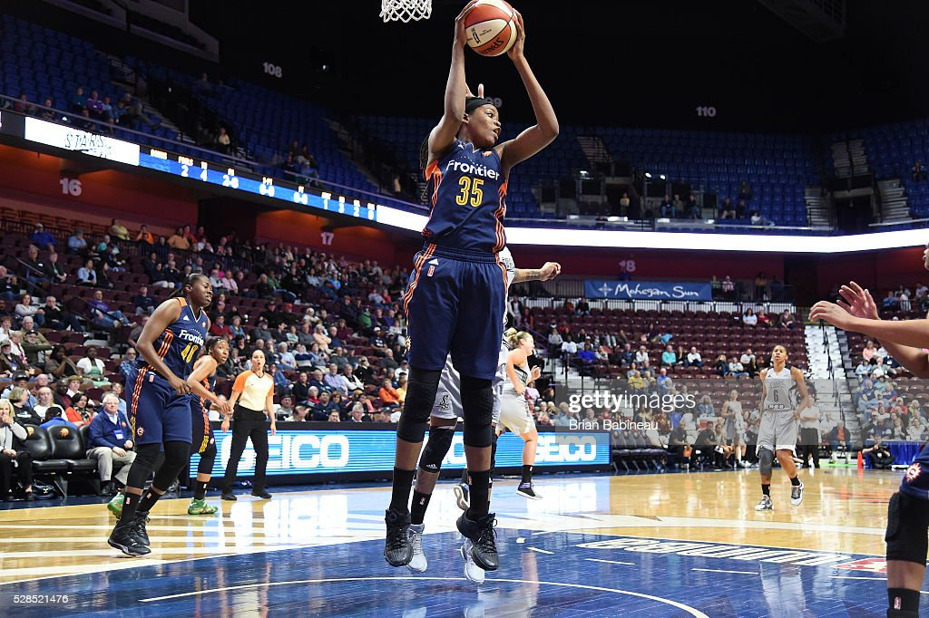 Jonquel Jones #35 of the Connecticut Sun grabs the rebound against the San Antonio Stars in a WNBA preseason game on May 5, 2016 at the Mohegan Sun Arena in Uncasville, Connecticut.