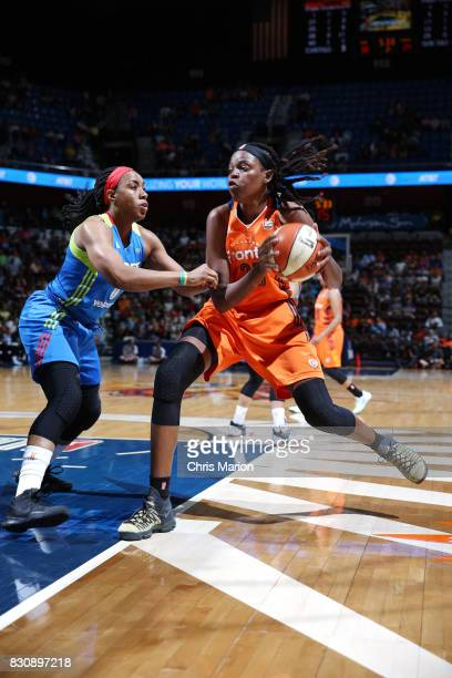 Jonquel Jones of the Connecticut Sun handles the ball against Kayla Thornton of the Dallas Wings on August 12 2017 at Mohegan Sun Arena in Uncasville...