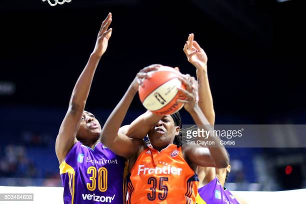 Jonquel Jones of the Connecticut Sun is fouled by Nneka Ogwumike of the Los Angeles Sparks during the Los Angeles Sparks Vs Connecticut Sun WNBA...