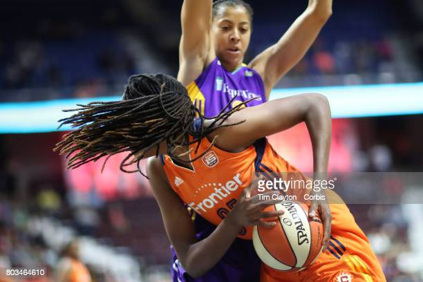 Jonquel Jones of the Connecticut Sun prepares to shoot while defended by Candace Parker of the Los Angeles Sparks during the Los Angeles Sparks Vs...