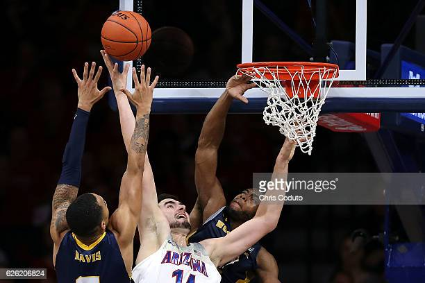 Jon'te Dotson of the Northern Colorado Bears and Jordan Davis fight for a rebound with Dusan Ristic of the Arizona Wildcats during the second half of...