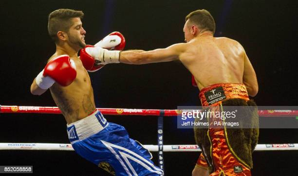 Jonthan Slowey knocks Angel Lorente to the floor during the vacant WBC International Silver featherweight title at the SECC Glasgow