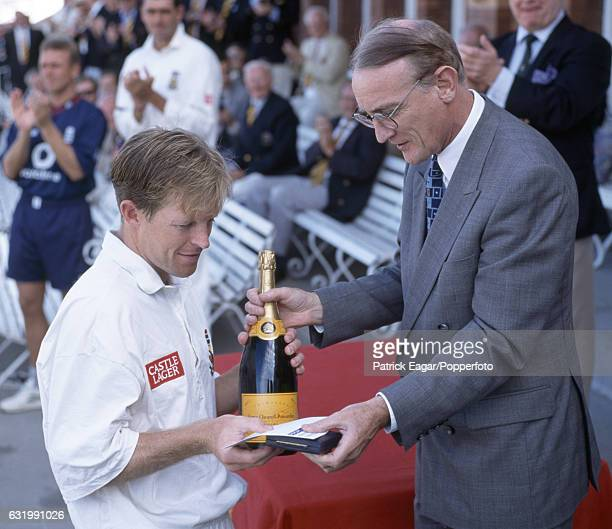 Jonty Rhodes of South Africa receives his Man of the Match award from Ray Treen of Cornhill Insurance at the end of the 2nd Test match between...