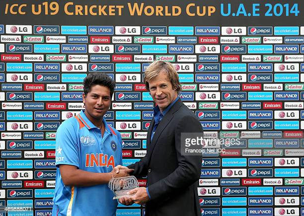 Jonty Rhodes presents Kuldeep Yadav of India with the man of the match award after during the ICC U19 Cricket World Cup 2014 match between India and...