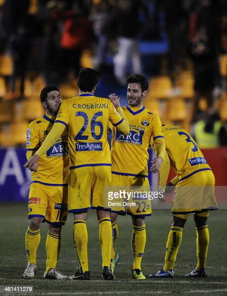 Jony celebrates with Chema and Daniel Pacheco of AD Alcorcon after their team beat Espanyol 10 in the Copa del Rey Round of 16 1st leg match between...