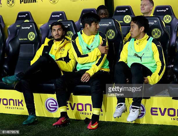 Joo Ho Park of Dortmund talks to team mate Shinji Kagawa before the Bundesliga match between Borussia Dortmund and Hertha BSC at Signal Iduna Park on...