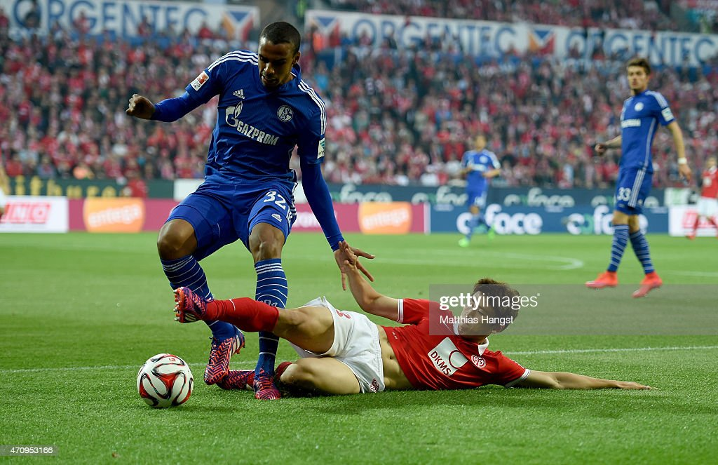 Joo Ho Park (R) of Mainz is challenged by <a gi-track='captionPersonalityLinkClicked' href=/galleries/search?phrase=Joel+Matip&family=editorial&specificpeople=4462851 ng-click='$event.stopPropagation()'>Joel Matip</a> of Schalke during the Bundesliga match between 1. FSV Mainz 05 and FC Schalke 04 at Coface Arena on April 24, 2015 in Mainz, Germany.