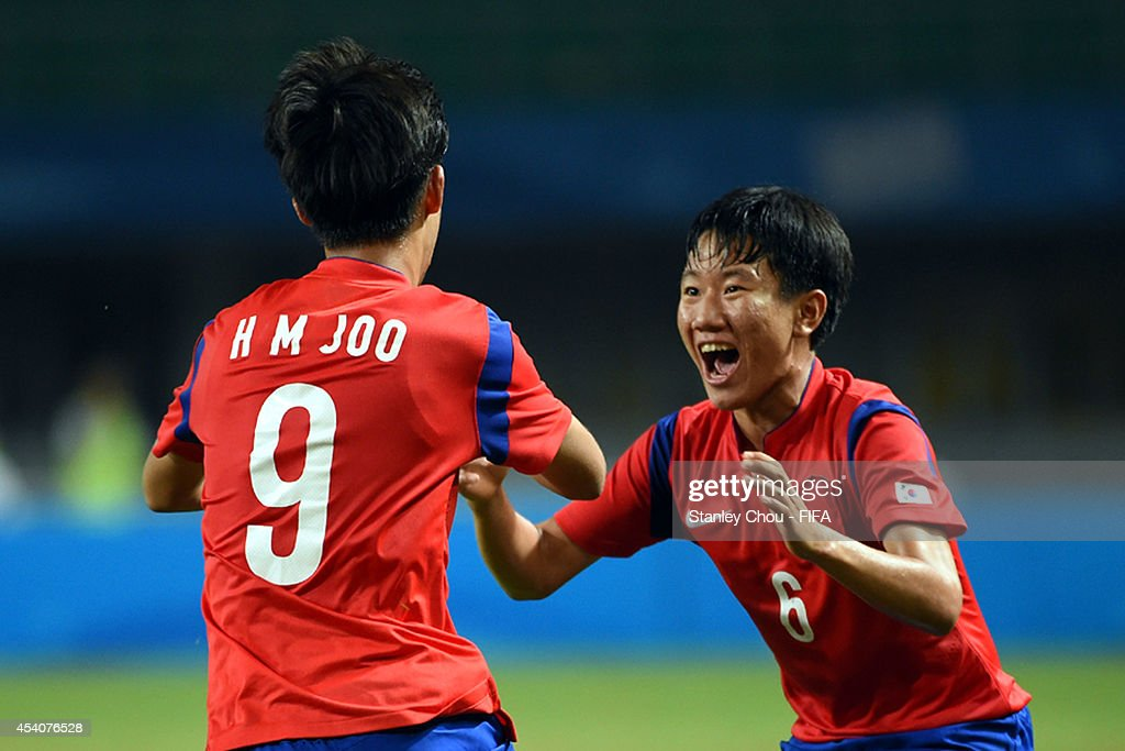 Joo Hwimin#9 of Korea Republic celebrates with Kim Chan after scoring the equaliser goal against Iceland during the 2014 FIFA Boys Summer Youth Olympic Football Tournament Semi Final match between Korea Republic and Iceland at Jiangning Sports Centre Stadium on August 24, 2014 in Nanjing, China.