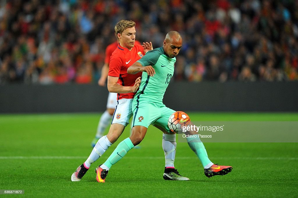 João Mário of Portugal challenges Ruben Jenssen of Norway during the International Friendly match between Portugal and Norway at Dragao Stadium on May 29, 2016 in Porto, Portugal.