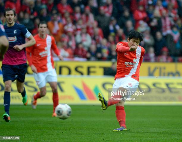 JooHo Park of Mainz is socring his teams opening goal during the Bundesliga match between FSV Mainz 05 and SC Freiburg at Coface Arena on February 1...