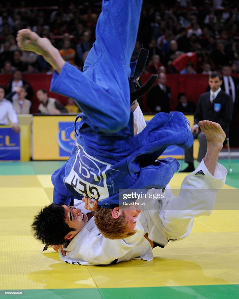 Joo-Jin Kim of Korea (white) throws Jonas Focke of Germany with a stomach throw for a yuko (5 points) on his way to the u66kgs gold medal during the Paris Tournament on day 1, Saturday, February 09, 2008 at the Palais Omnisports de Paris Bercy Sports Arena, Bercy, Paris, France.