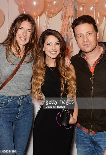 Jools Oliver Zoe Sugg and Jamie Oliver attend YouTube phenomenon Zoe Sugg's launch of her debut beauty collection at 41 Portland Place on September...
